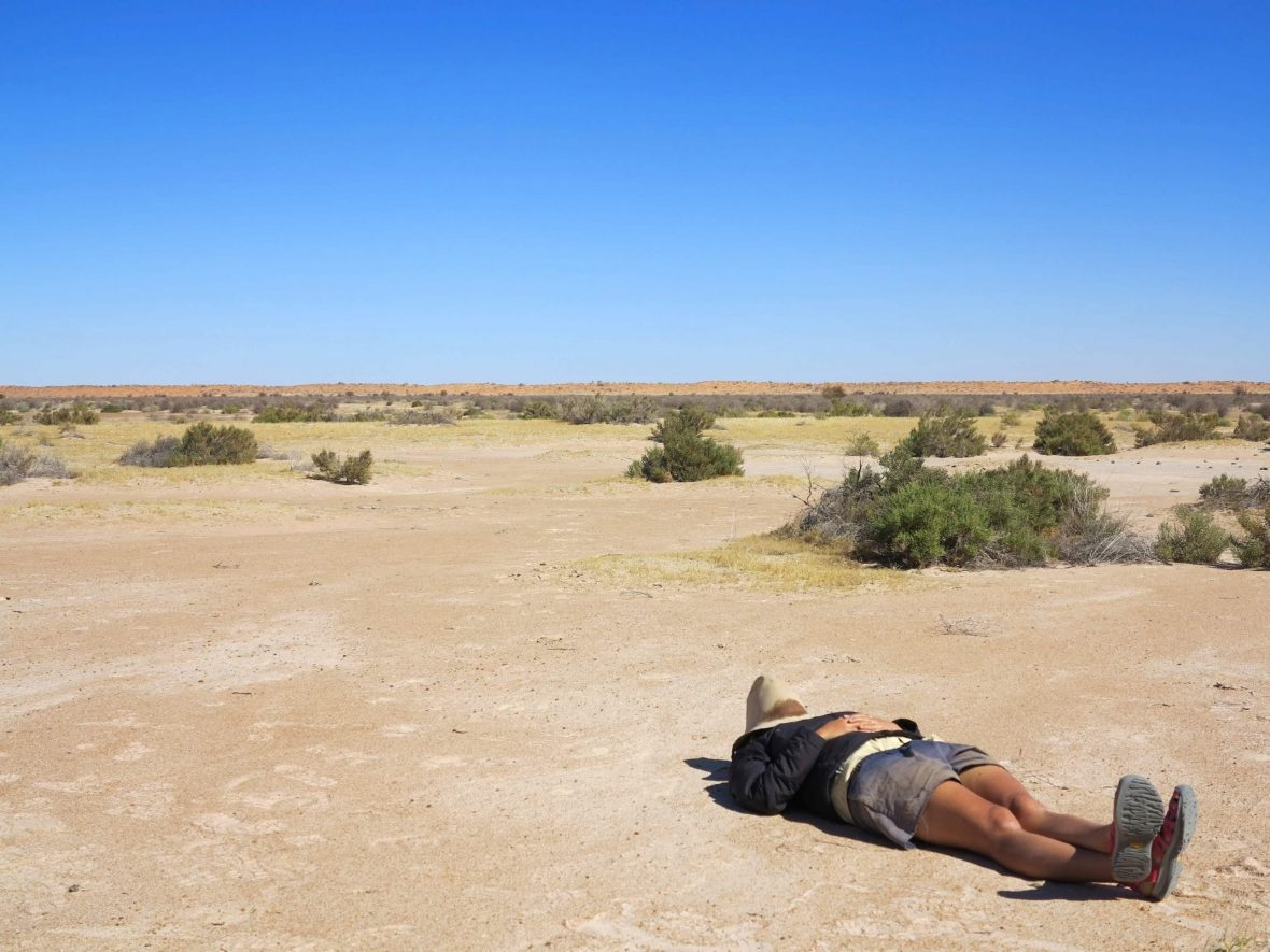 A botanist takes a snooze in the Simpson Desert.