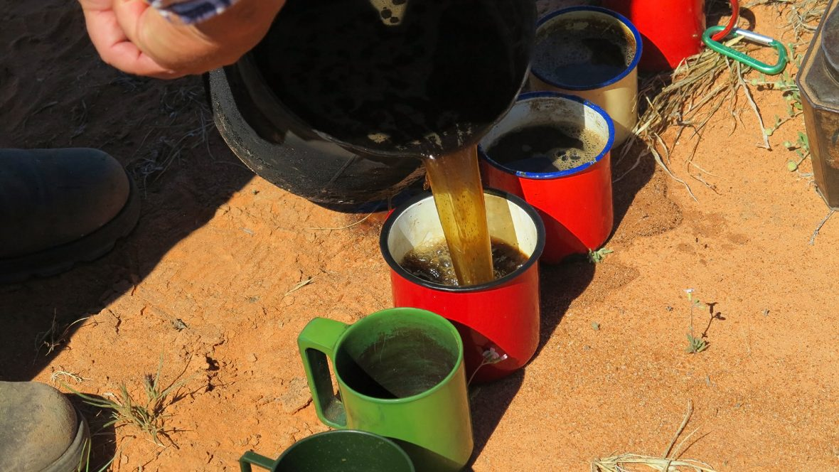 Pouring a coffee in the Simpson Desert.
