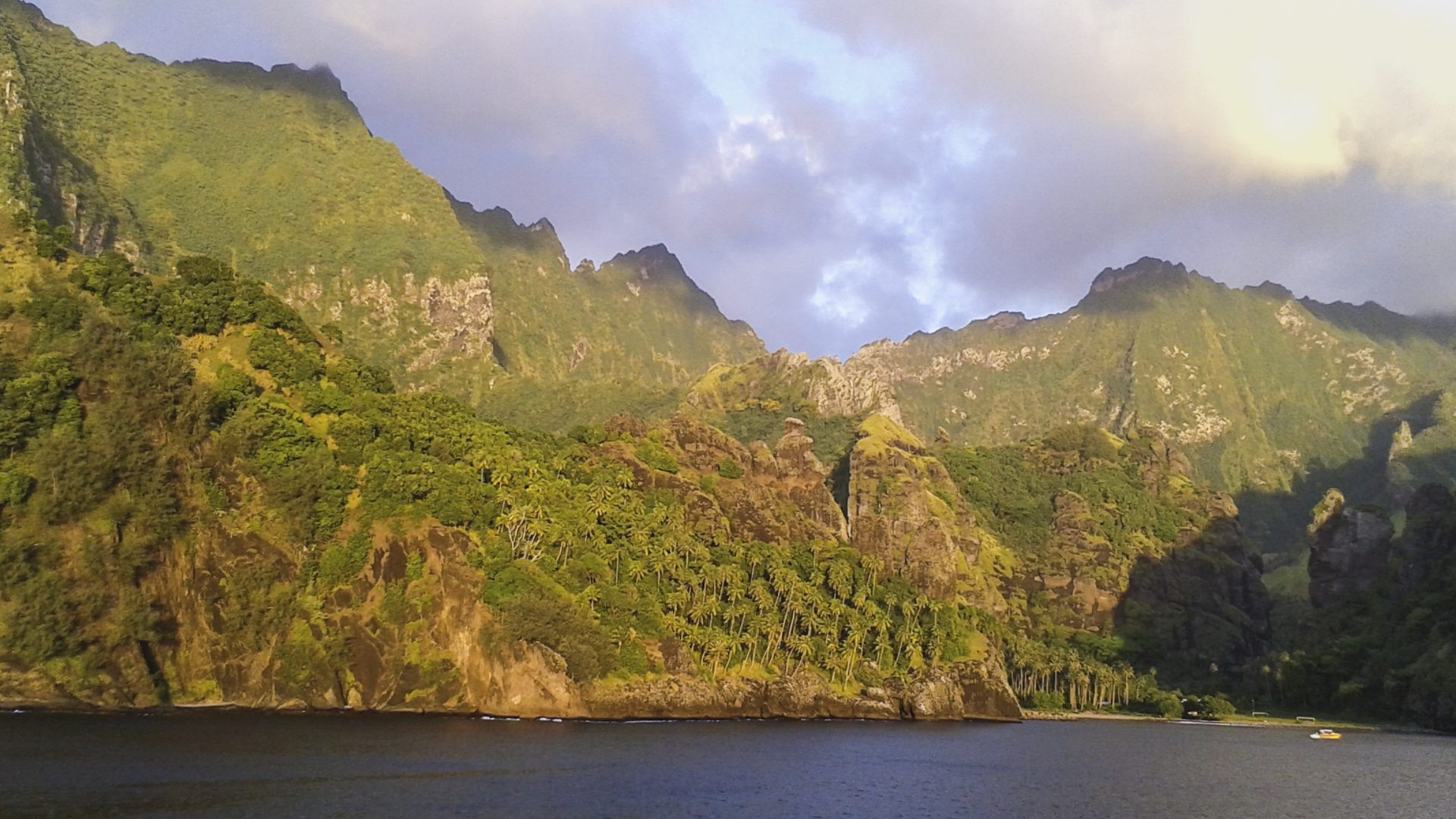 Hanavave harbour or Bay of Virgins on the island of Fatu Hiva in the Marquesas Islands, French Polynesia, sunset stop for Aranui 3 cargo cruise ship
