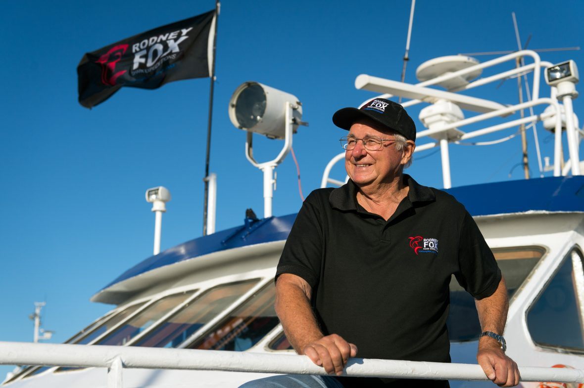 Rodney Fox aboard one of their cage diving expedition boats.