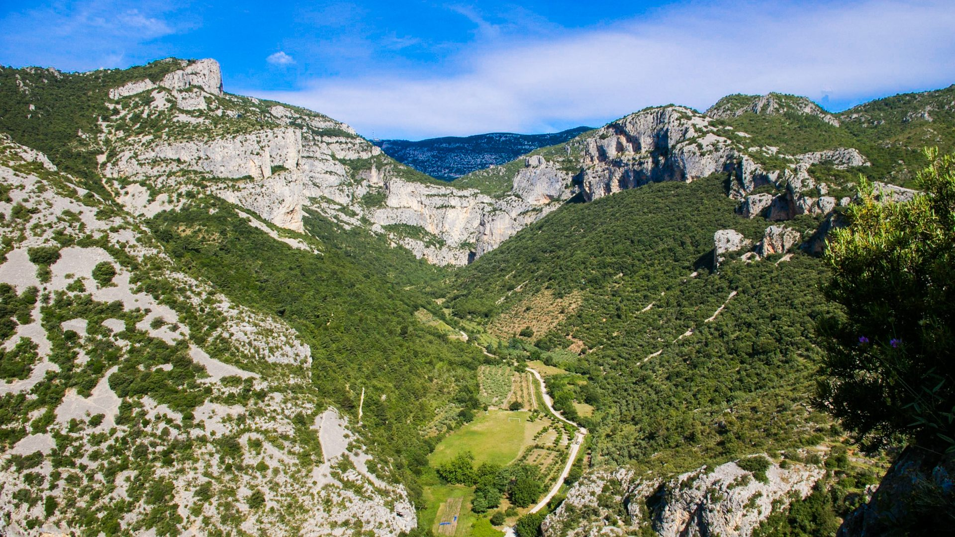 Aerial view of green mountains in the Vallée de l'Hérault: kayaking in France