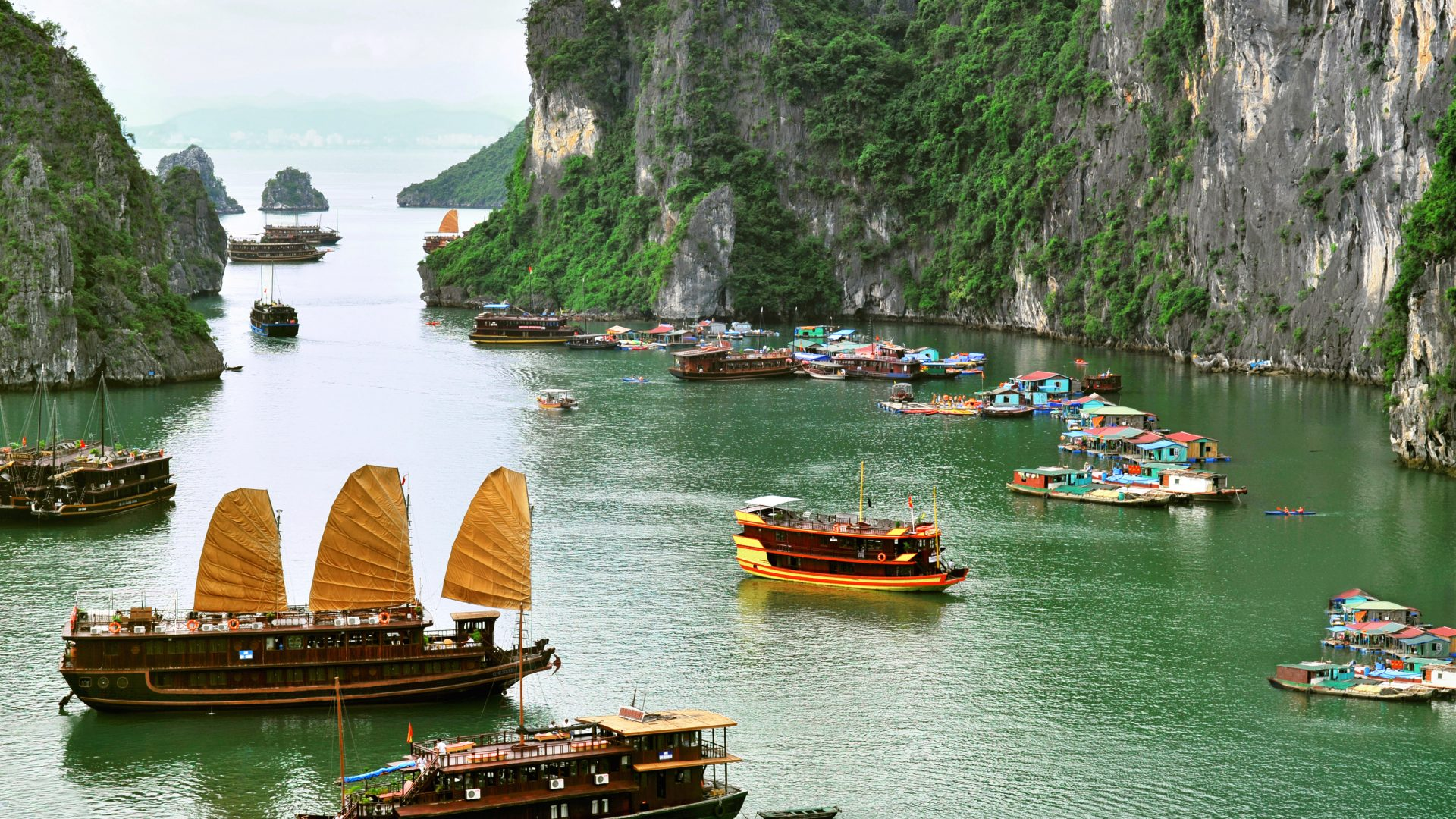 Tourist Junks and Floating village in Halong Bay, Vietnam.