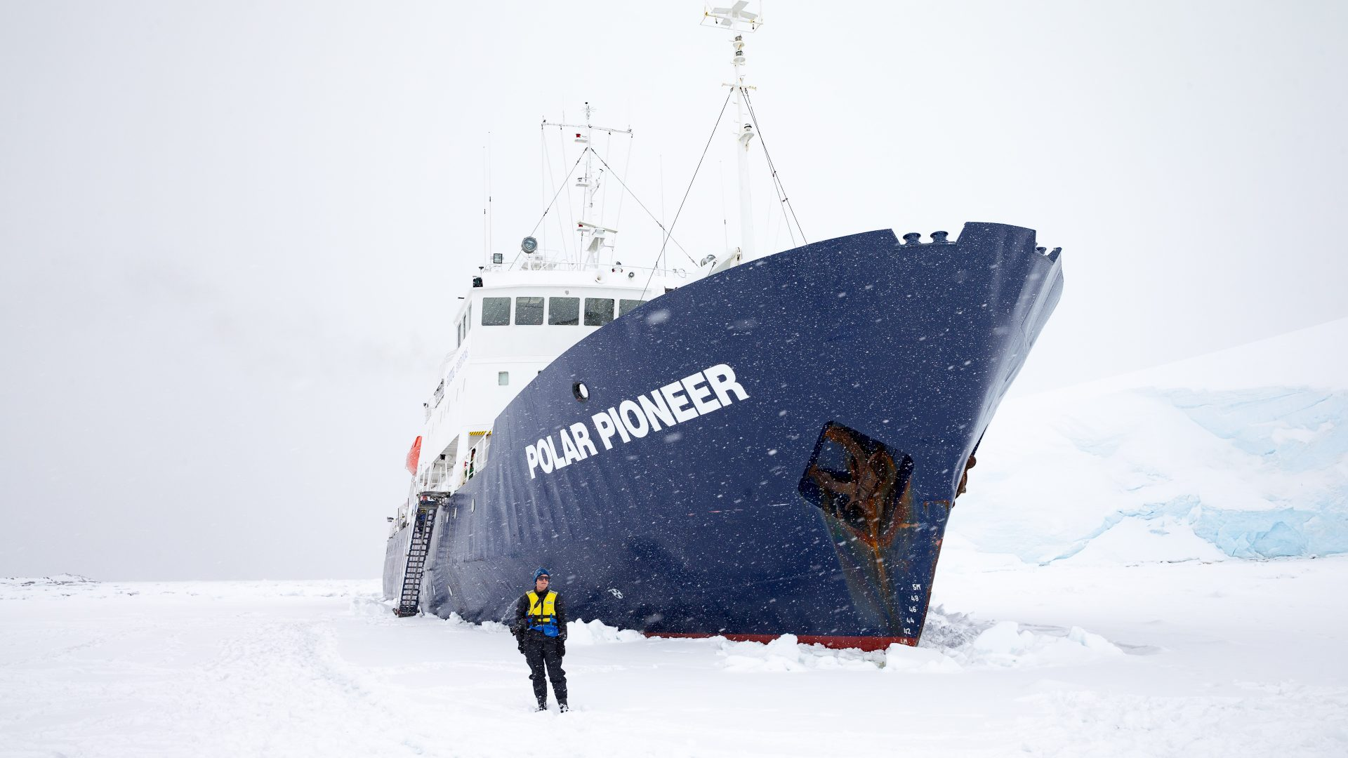 The photographer in front of the Polar Pioneer ship in Antarctica.