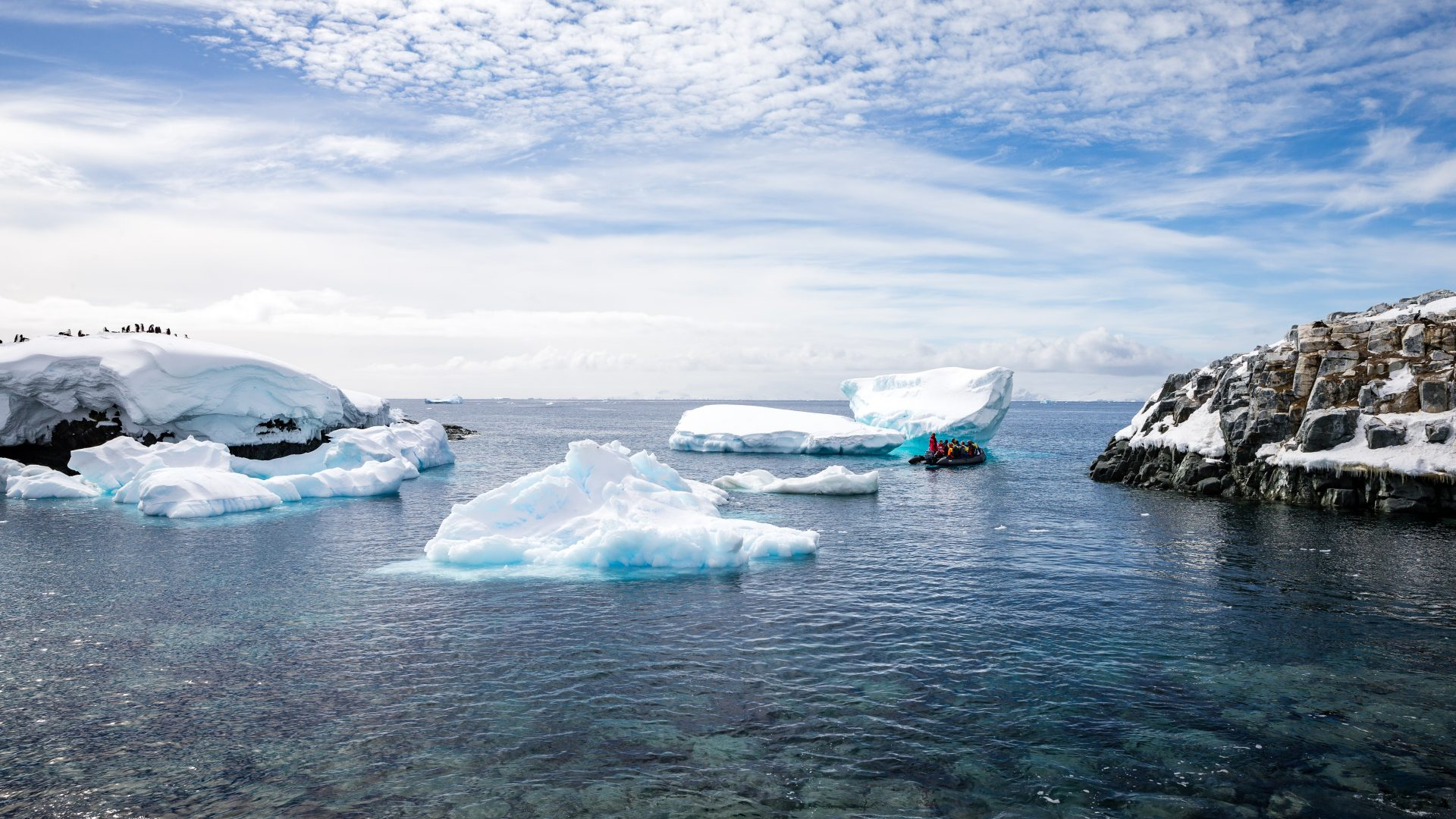 Zodiacs approach the icebergs in Antarctica.