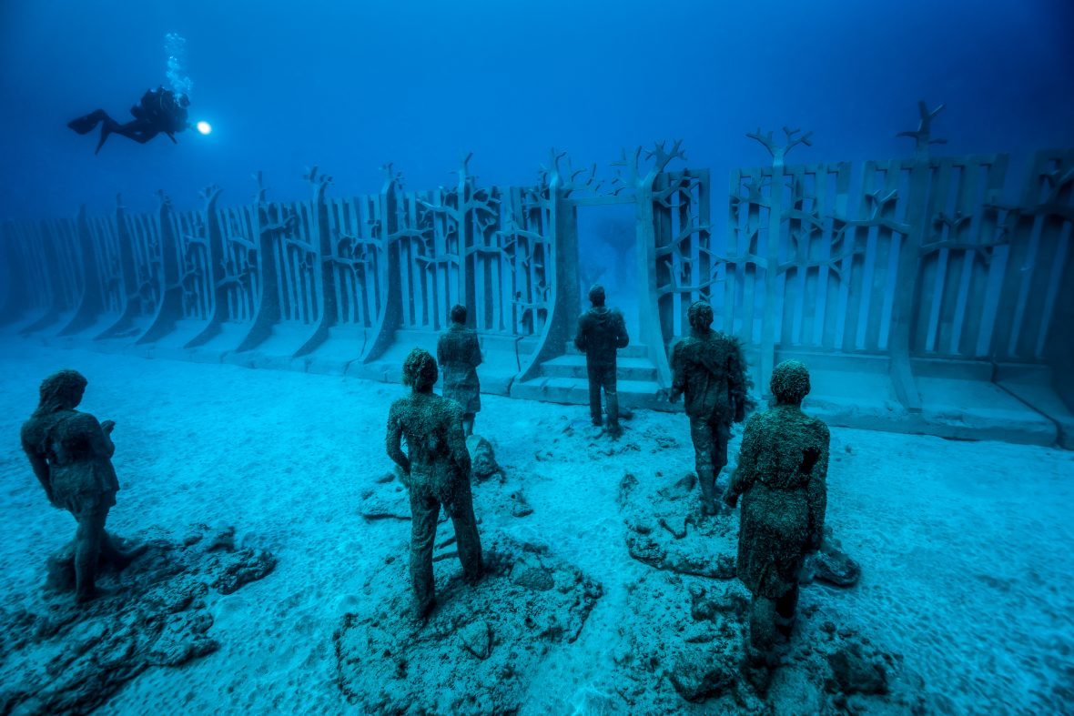 One of the pieces (Crossing the rubicon) in the underwater sculptural piece known as Vicissitudes by British artist Jason deCaires Taylor.