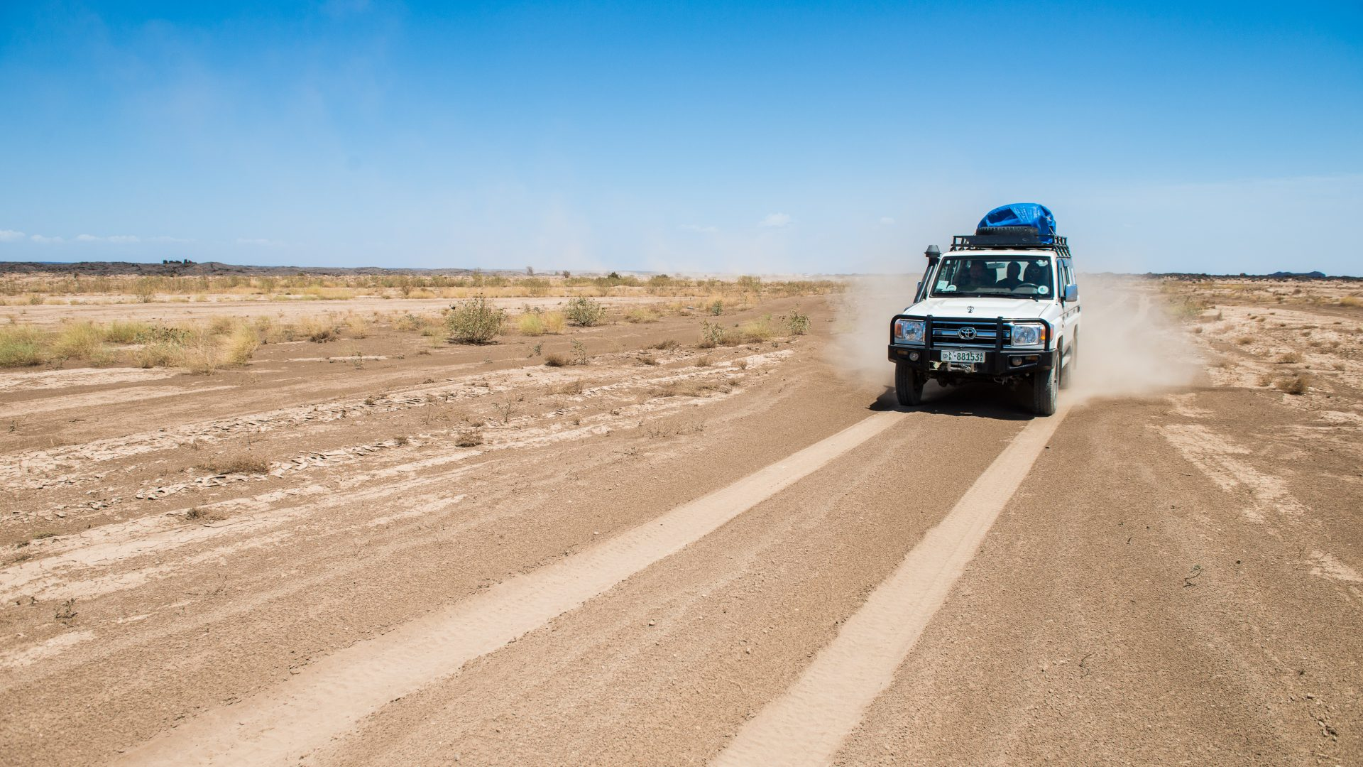 A jeep drives one of the dirt roads in the Danakil Depression