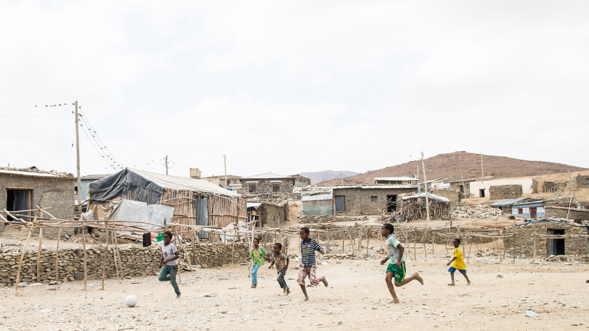 Children play soccer at a township in the area of the Danakil Depression in Ethiopia.