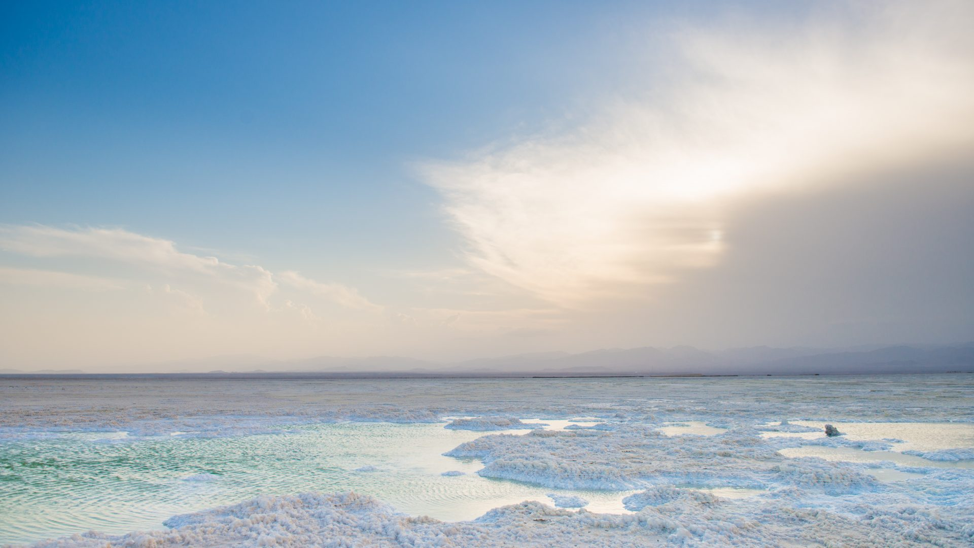 As the sun sets, small pools are visible in the pristine salt of the salt plains in the North East of Ethiopia.