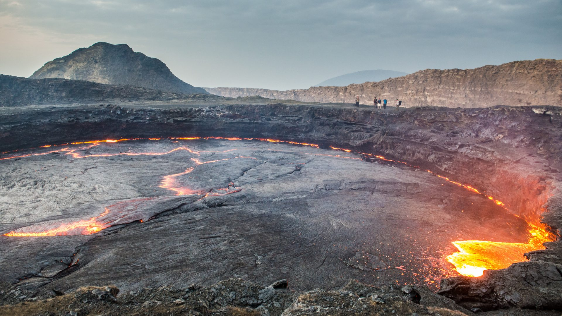 Tourists can be seen on the far rim of the Erta Ale volcano in Ethiopia.