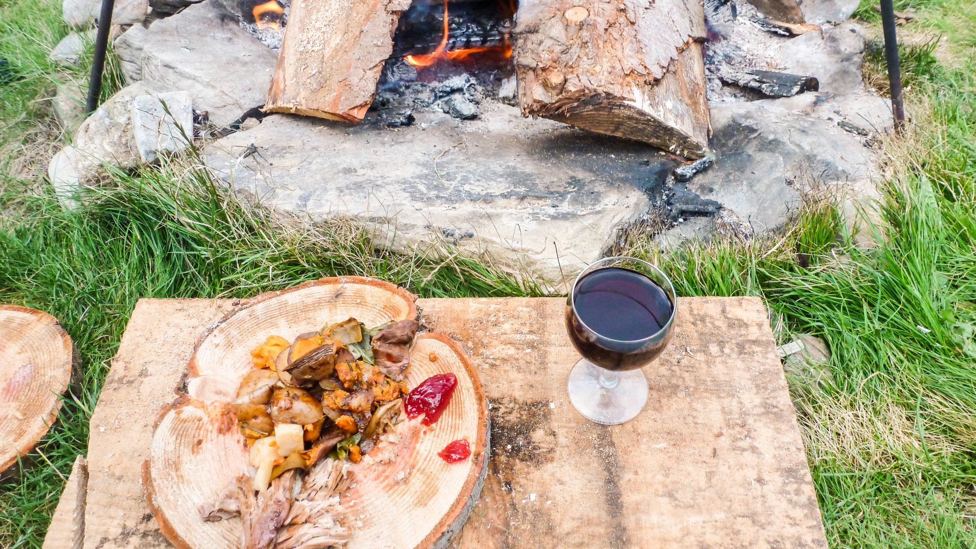 Experiencing nature: Enjoying pit-roasted meal by campfire, Prehistoric Cookery