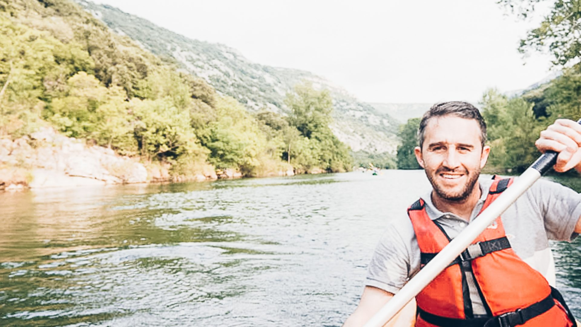 Max's face is visible as he kayaks down the river in Vallée de l'Hérault: kayaking in France