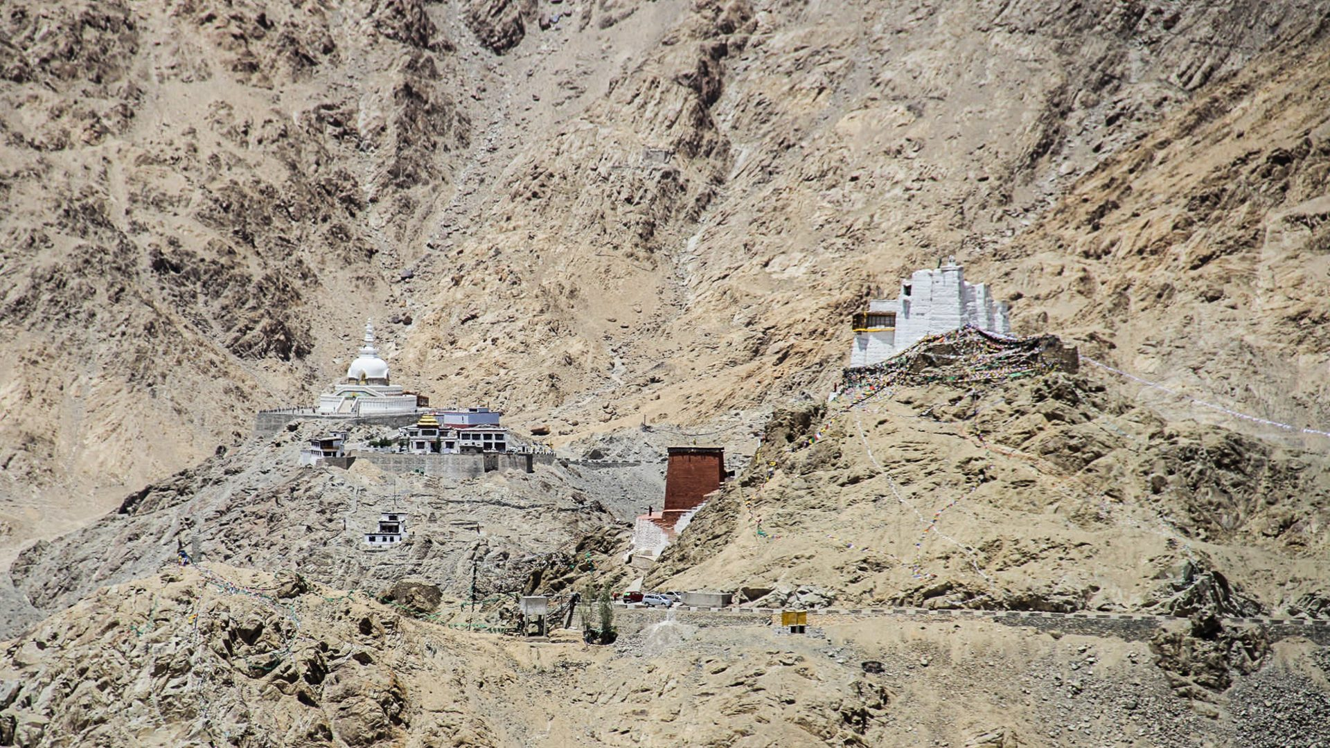 Buildings nestled in the mountainous terrain of the Indus Valley, Ladakh in the Himalayas.