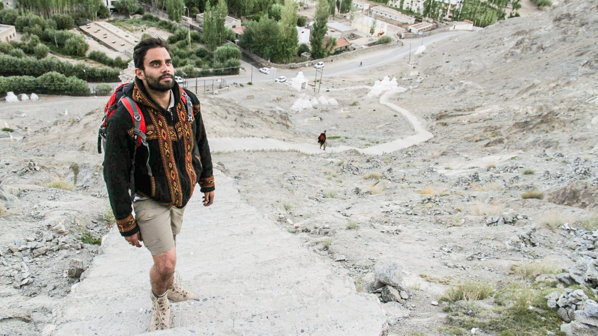 Writer Ash Bhardaj climbs up a steep hill in the Indus Valley, Ladakh, Himalayas.