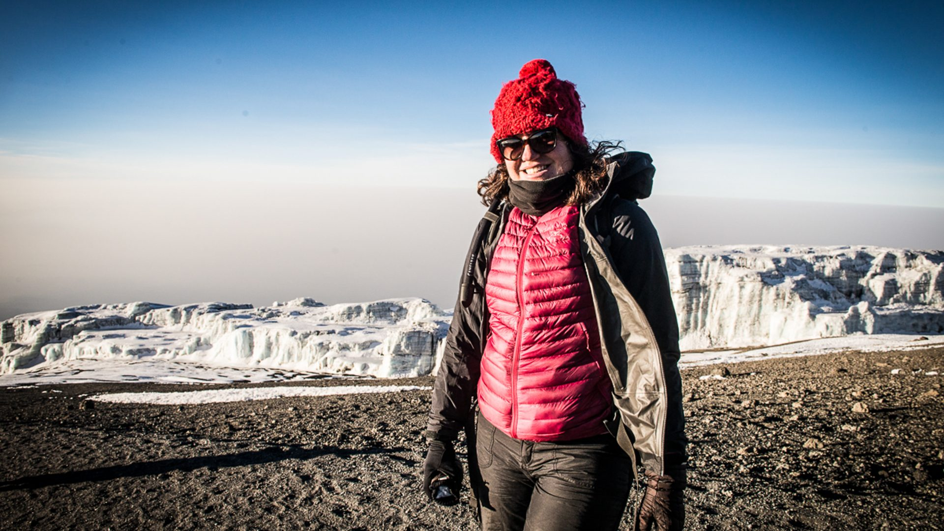 Kathleen Rellihan contributor profile photo. Standing on the summit of Mt Kilimanjaro