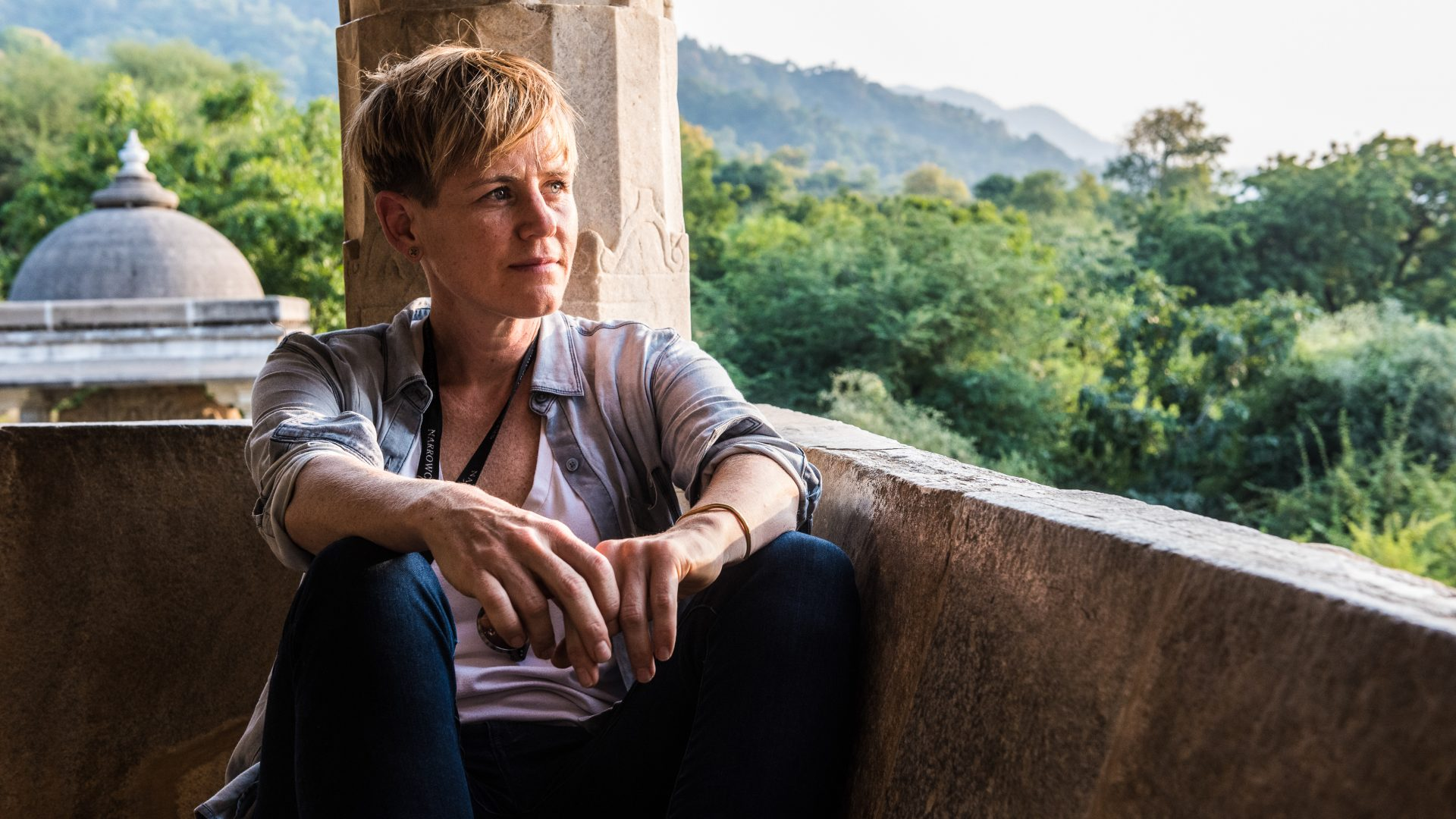 Contributor profile photo of Nicola Bailey. Looking peaceful at a temple in India