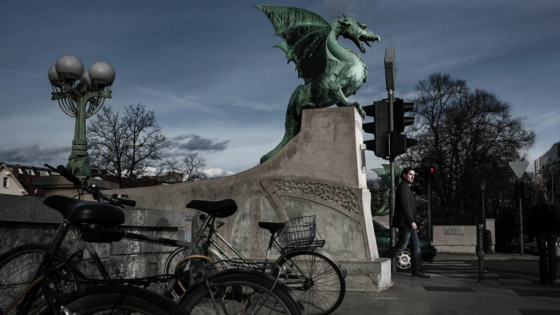 Contributor profile picture of Noah Charney. Walking past the dragon bridge in Ljubljana, Slovenia
