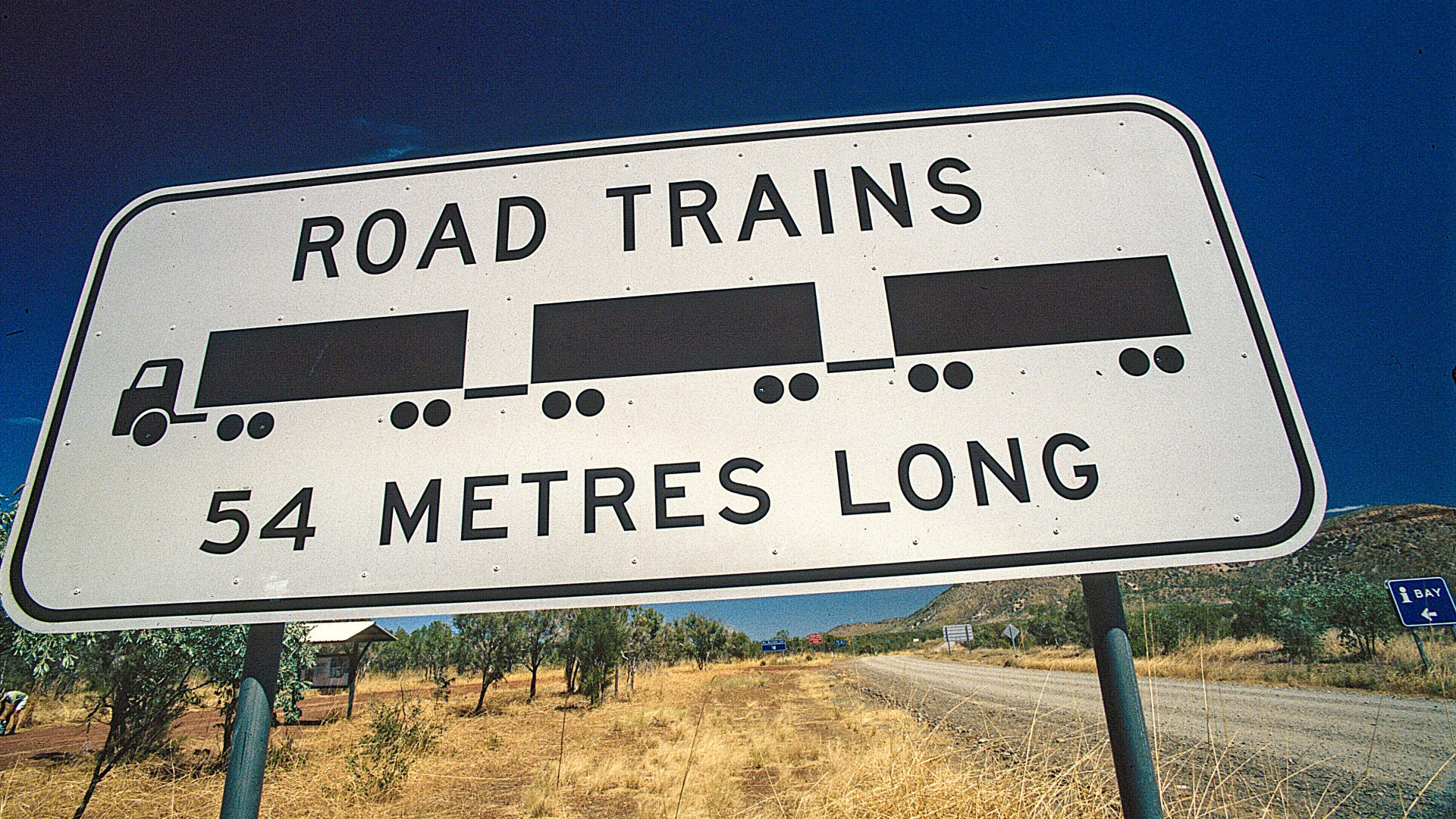 A sign in outback Australia alerts drivers to 54-metre-long road trains.
