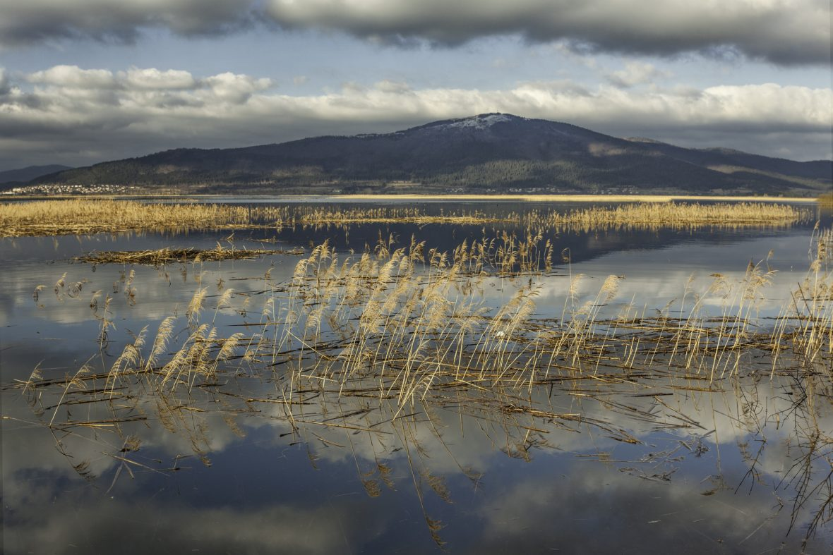 Cerknica intermittent lake with the background of Slivnica Mountain.