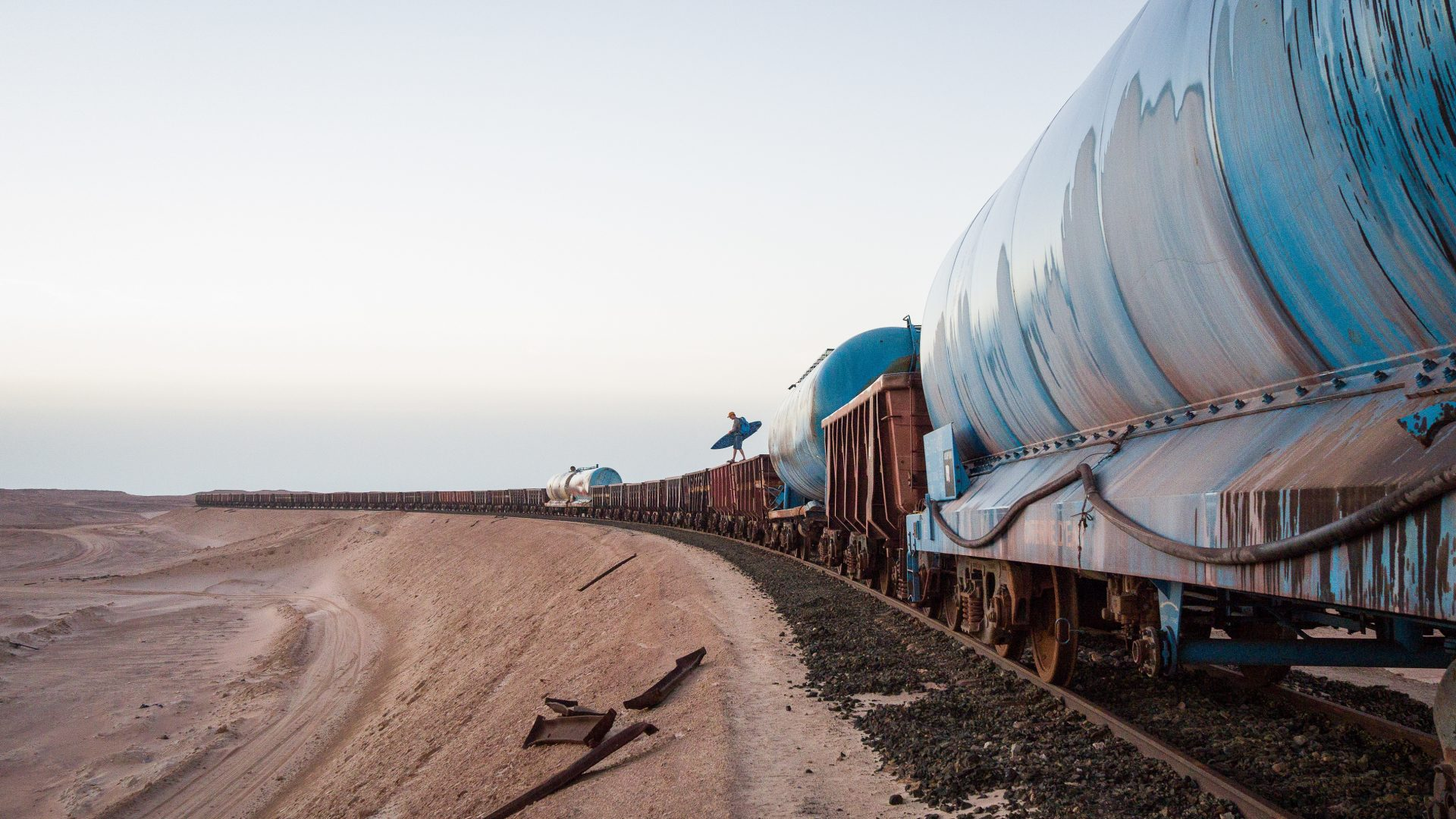 A small figure can be seen hitching a ride onboard one of the longest trains in the world.