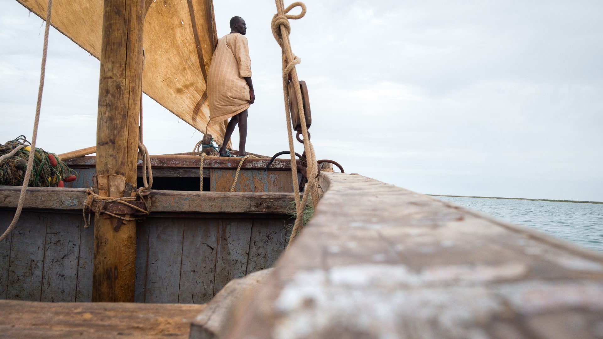An Imraguen fisherman surveys the ocean looking for fish.