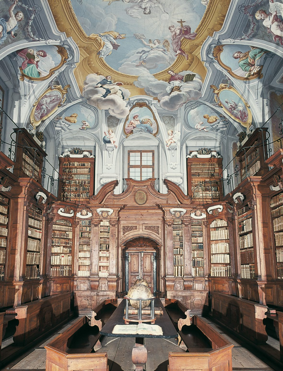 The Seminary library in Ljubljana with its elaborately painted Baroque ceiling.