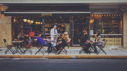 People enjoy outdoor seating at a cafe in Europe.