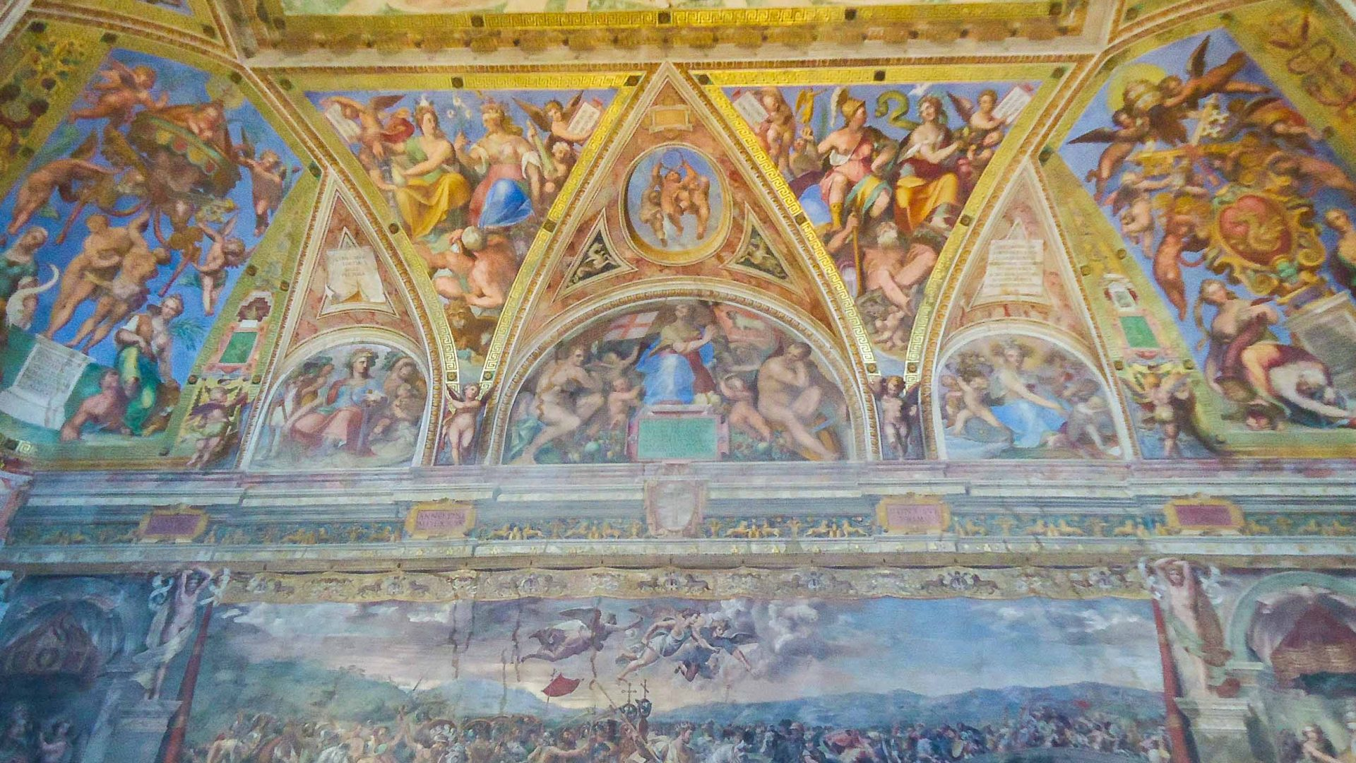 Frescos in the Raphael Rooms of the Vatican museum.
