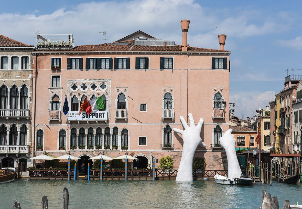 Lorenzo Quinn's sculpture of large hands coming out of the Grand Canal, Venice.