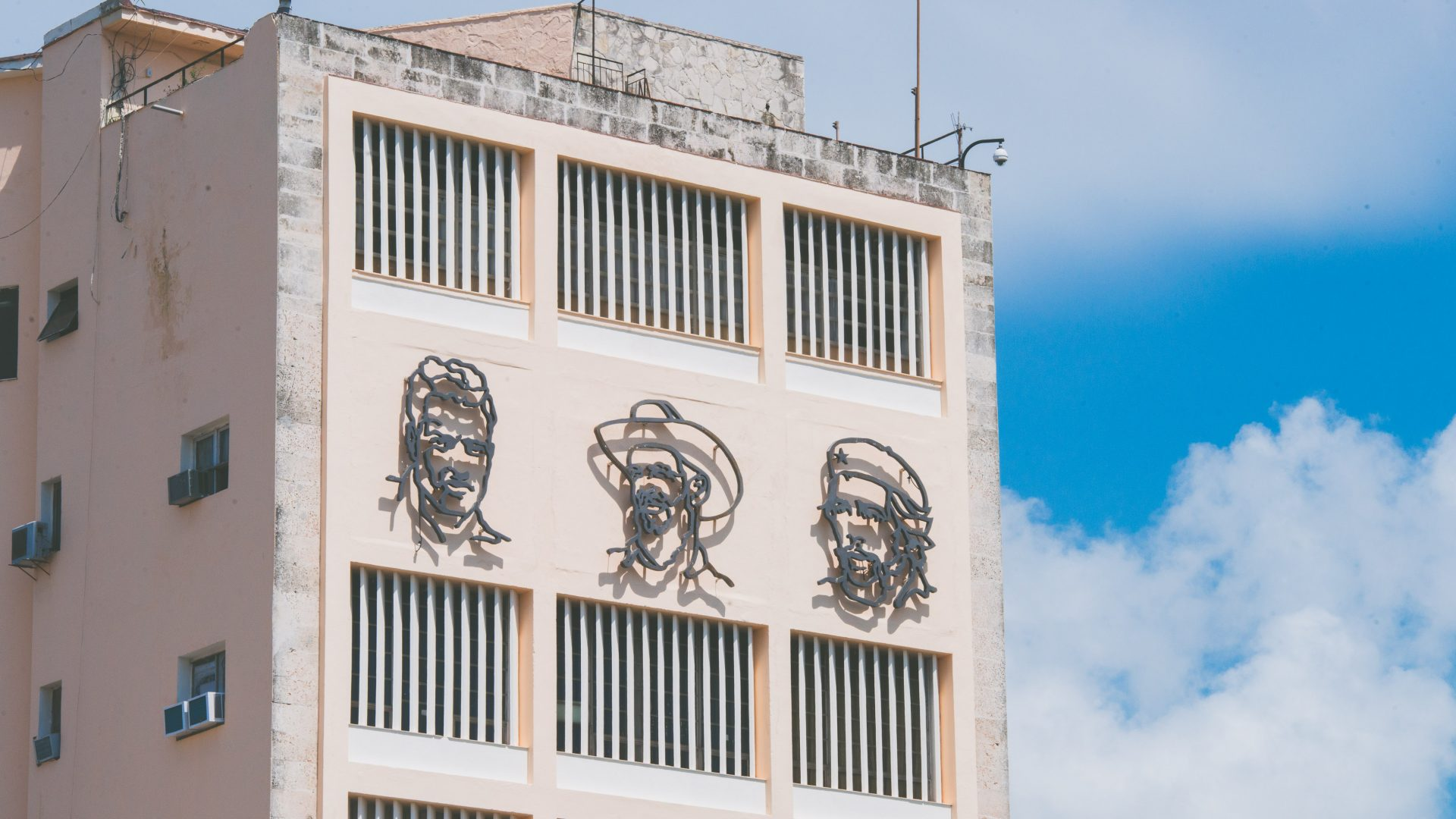 A building in Cuba shows the faces of Fidel, Che and Marti - recognized by many as revolutionaries.