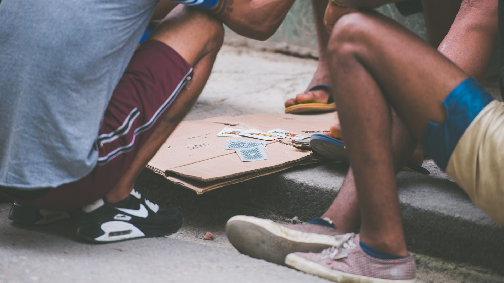People play cards in the streets of Central Havana, Cuba.