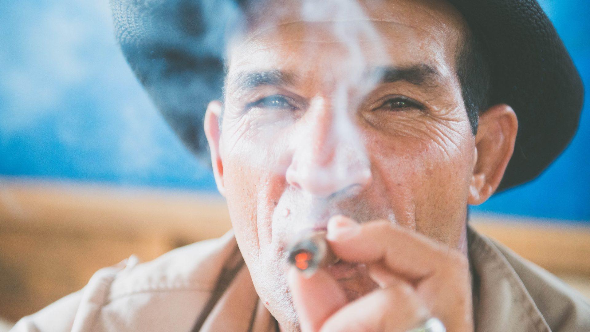 A man smokes a cigar at a tobacco plantation on the outskirts of Viñales, Cuba.