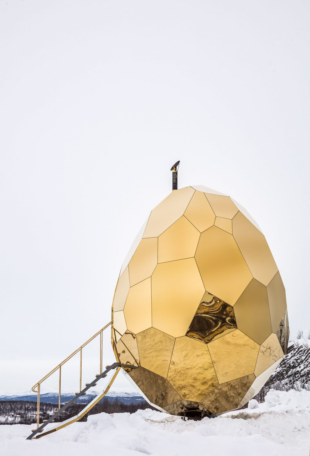 The solar golden egg sauna stands remarkable in the cold Swedish landscape.