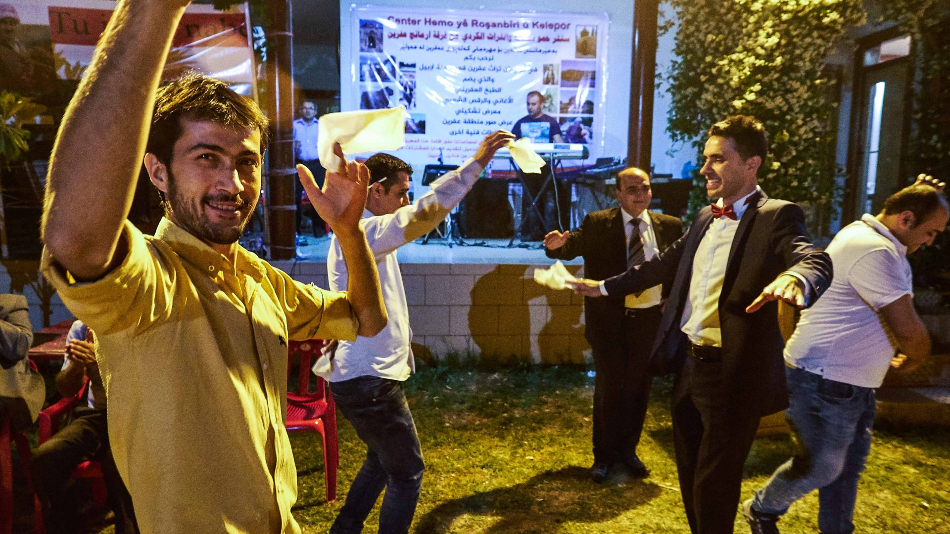 People dance in the street in Erbil, Iraq.
