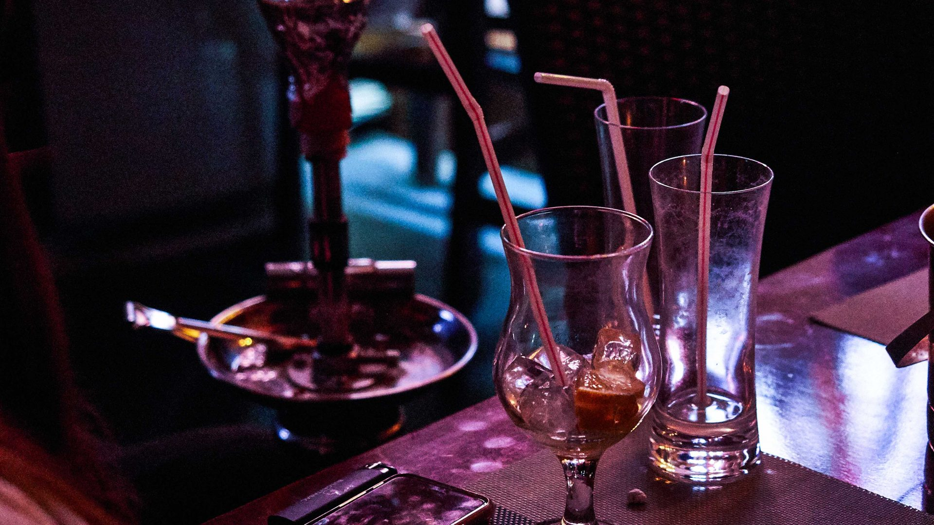 A hookah pipe and empty glasses at a bar in Bazari Nishtiman, Erbil, Iraq.
