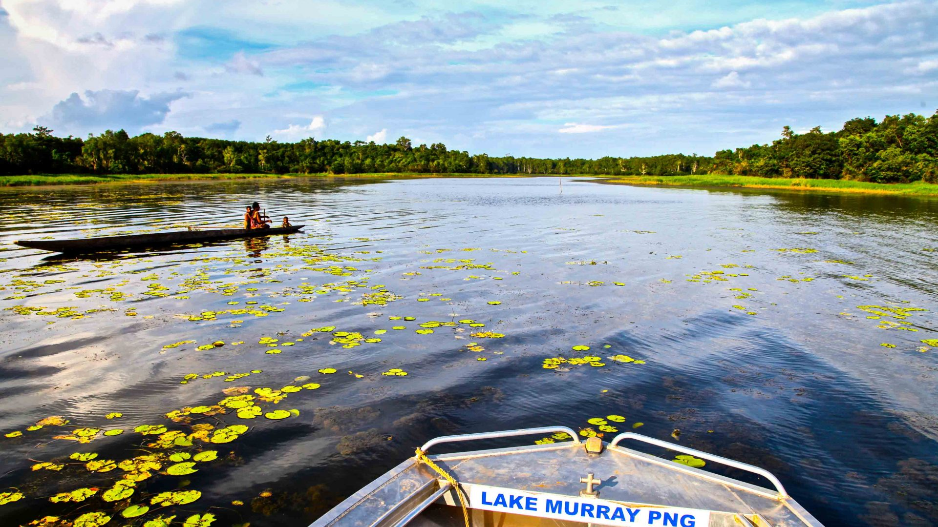 The tip of a small boat indicates the location of this fishing expedition, in Lake Murray, PNG.