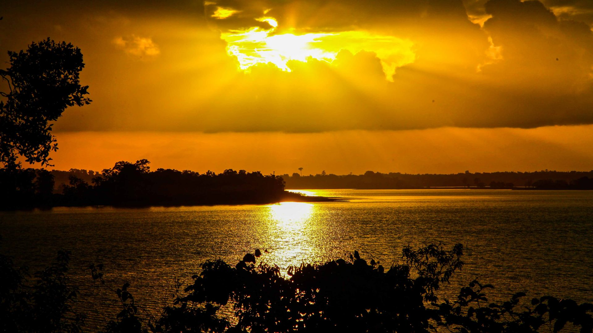 The sun sets over Lake Murray, PNG.