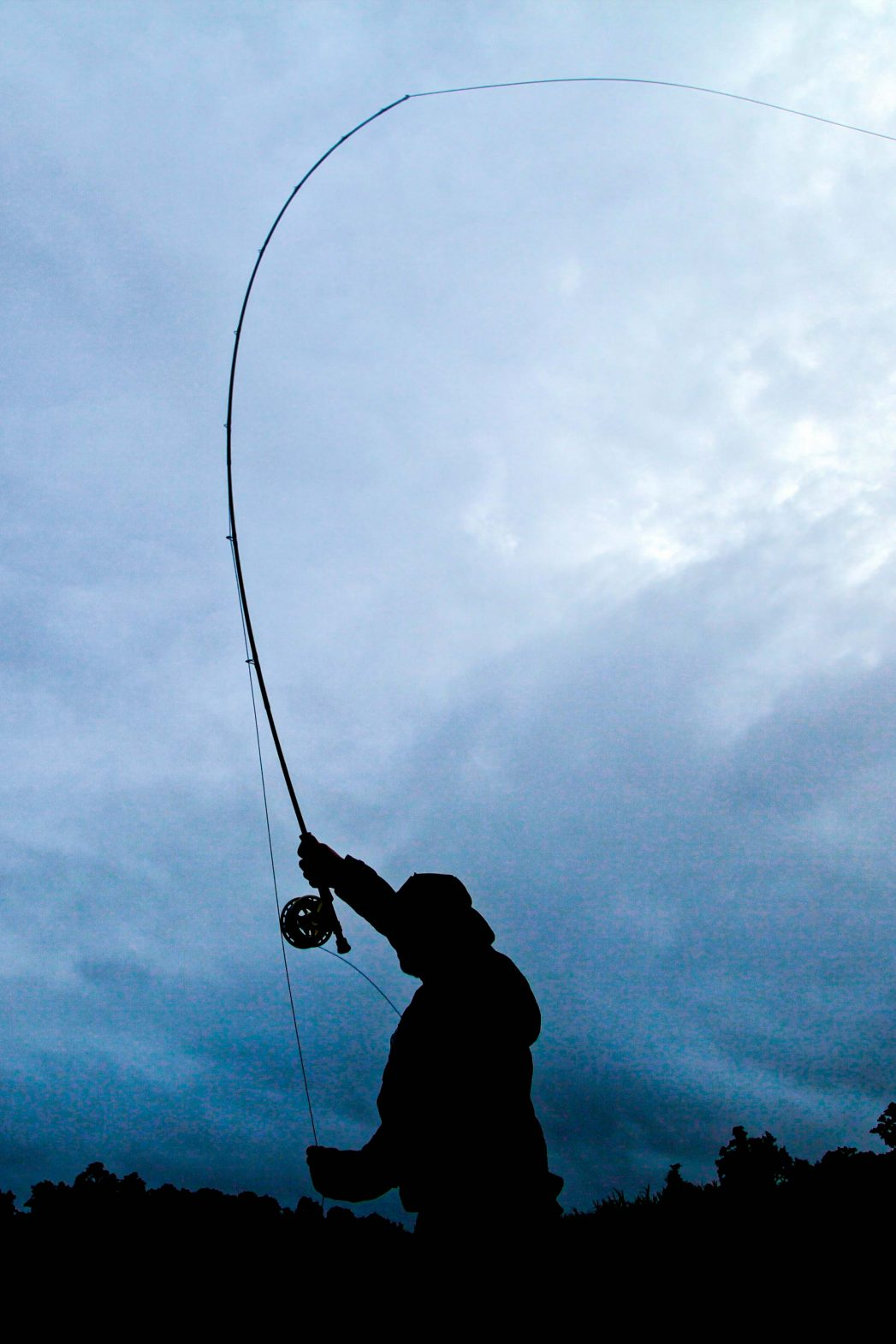 The silhouette of a fisherman during a fishing expedition to lake Murray in PNG.