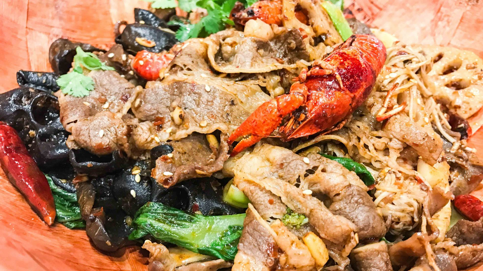 Sichuan matalang with beef and crawfish is served up at an eatery in Flushing, Queens.