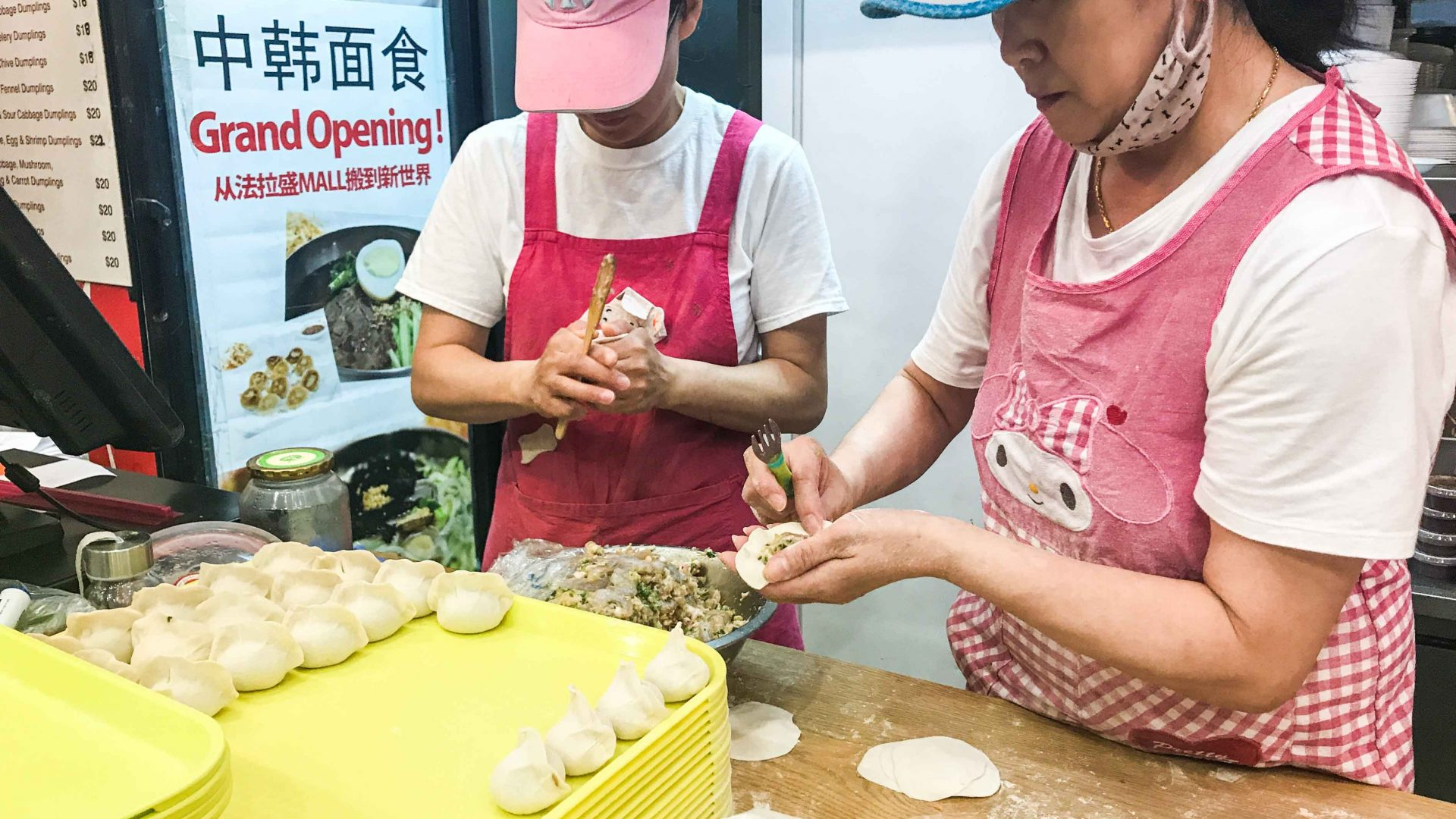 Women make dumplings in Flushing, Queens.