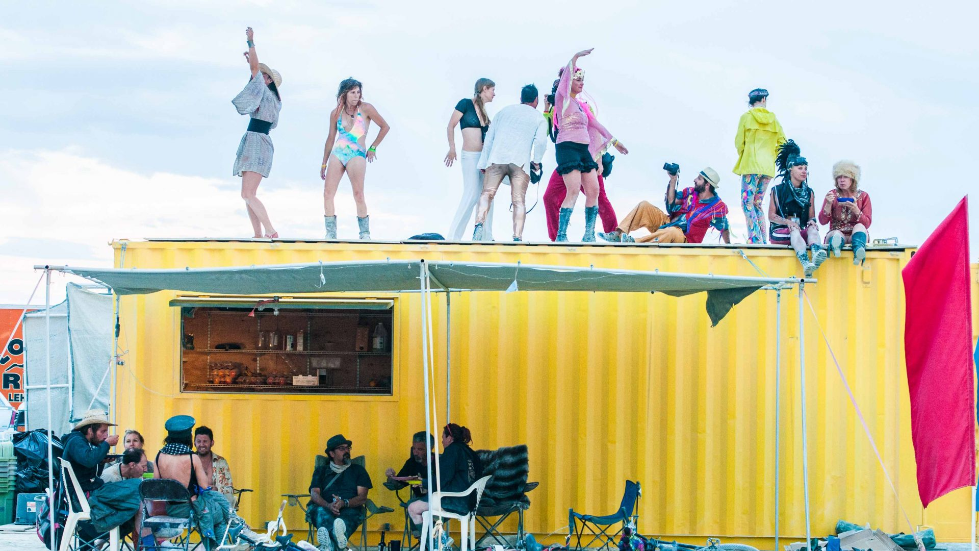 Attendees of Burning Man spend the afternoon dancing on their cargo container.