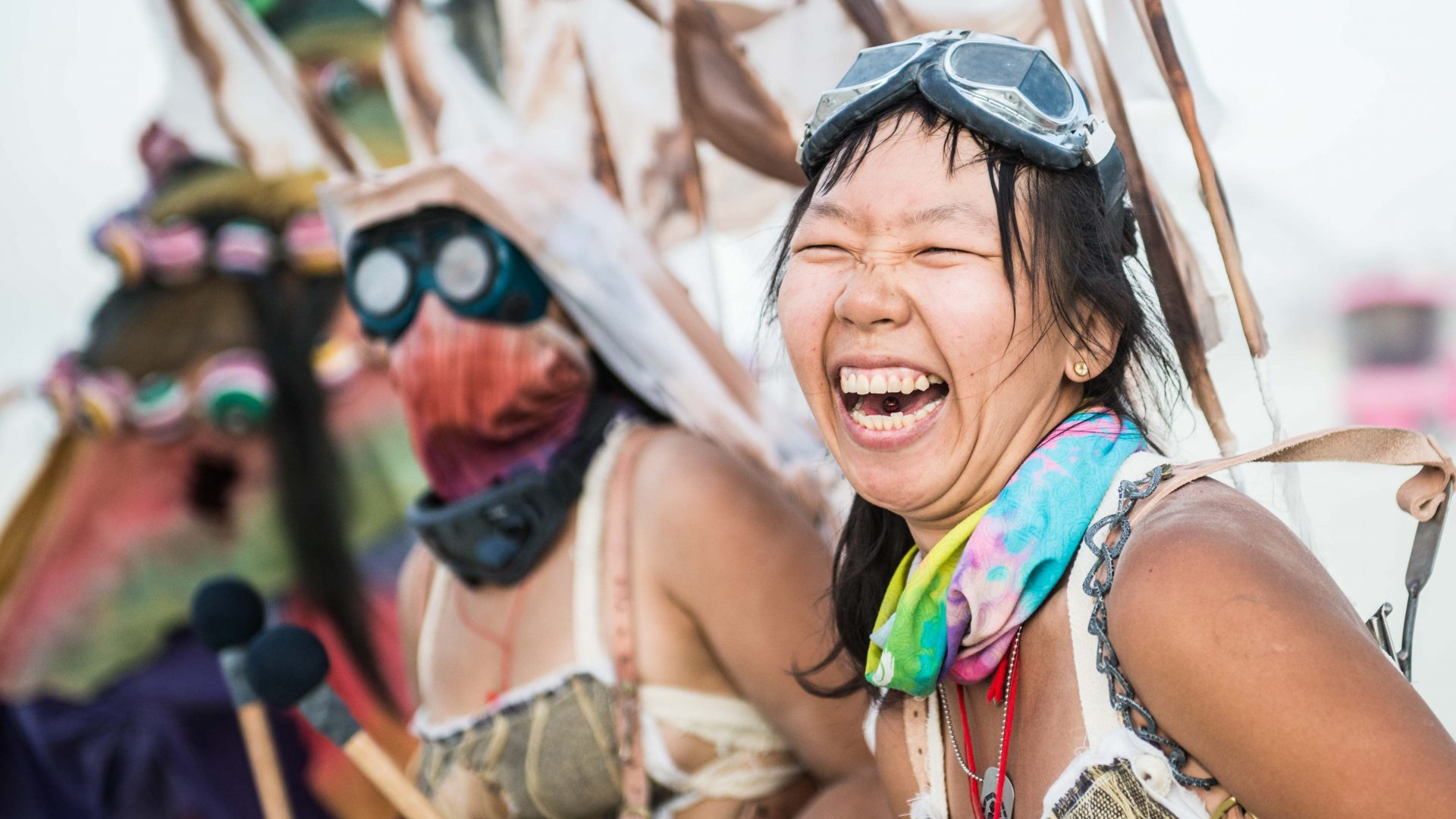 A woman laughs during a parade through the streets of Burning Man.