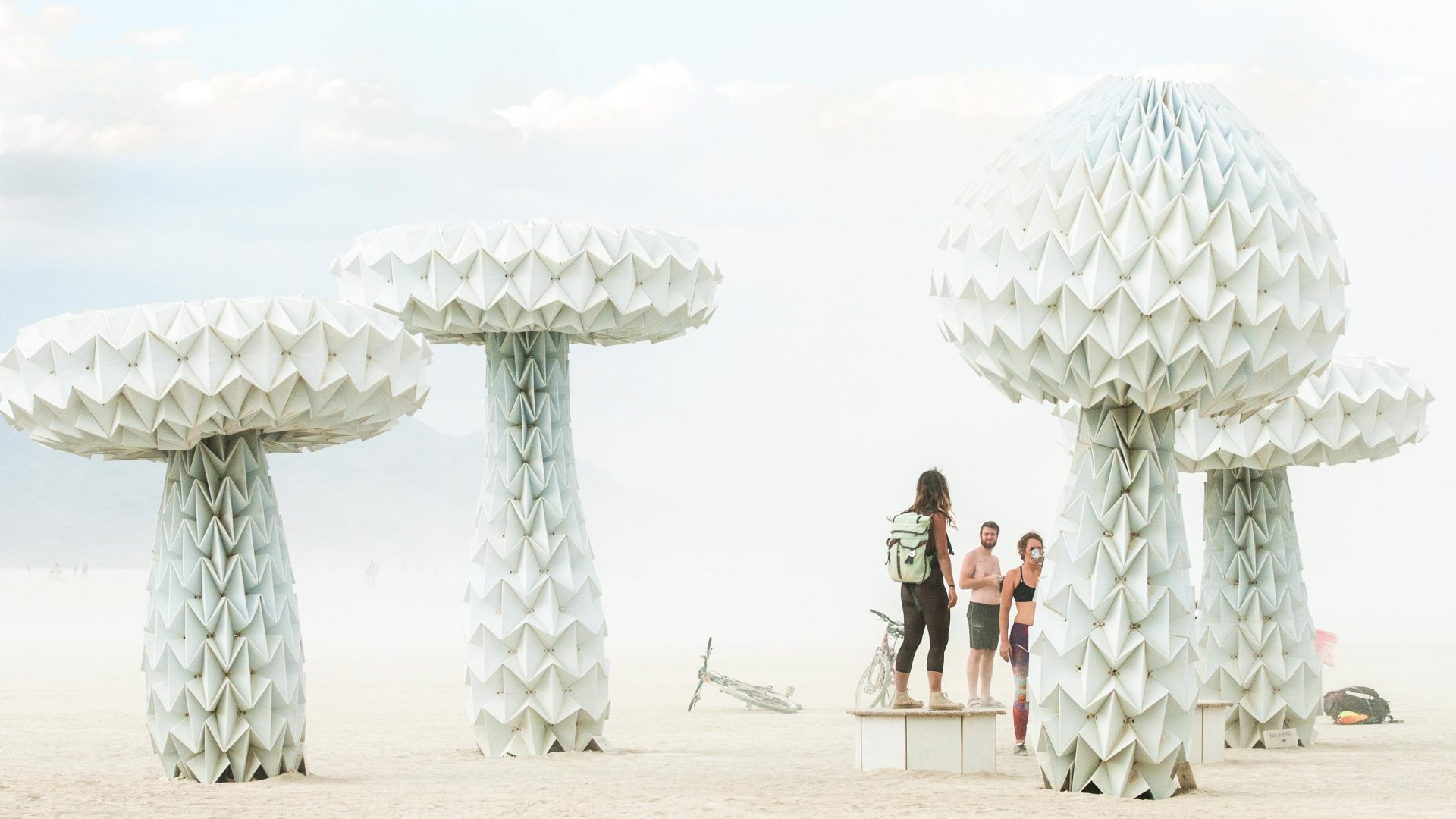 People stand around one of the art pieces at Burning Man.