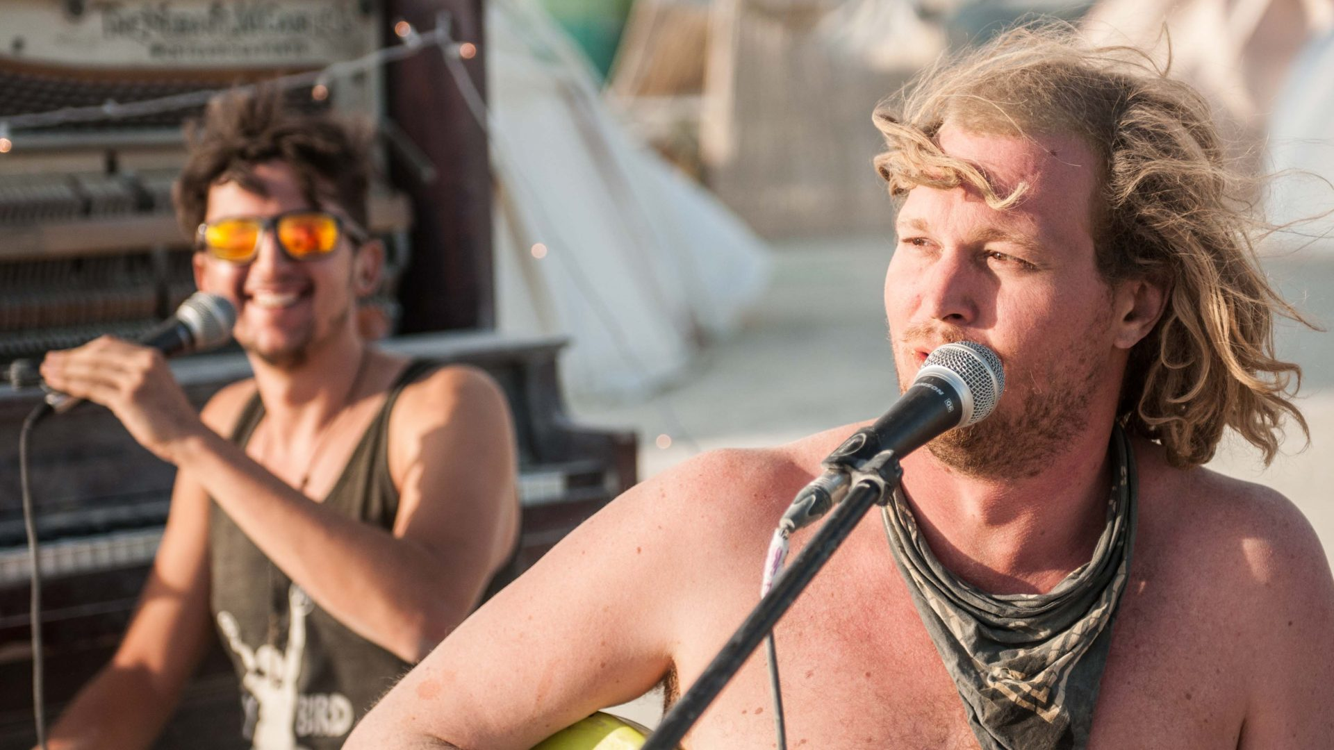 A couple of guys perform for whoever cares to listen at Burning Man.