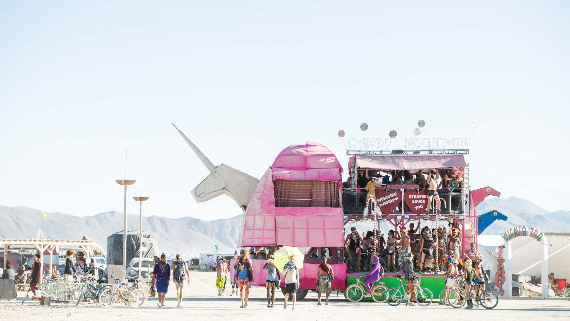 Attendees at the annual Burning Man fill a unicorn inspired art car.