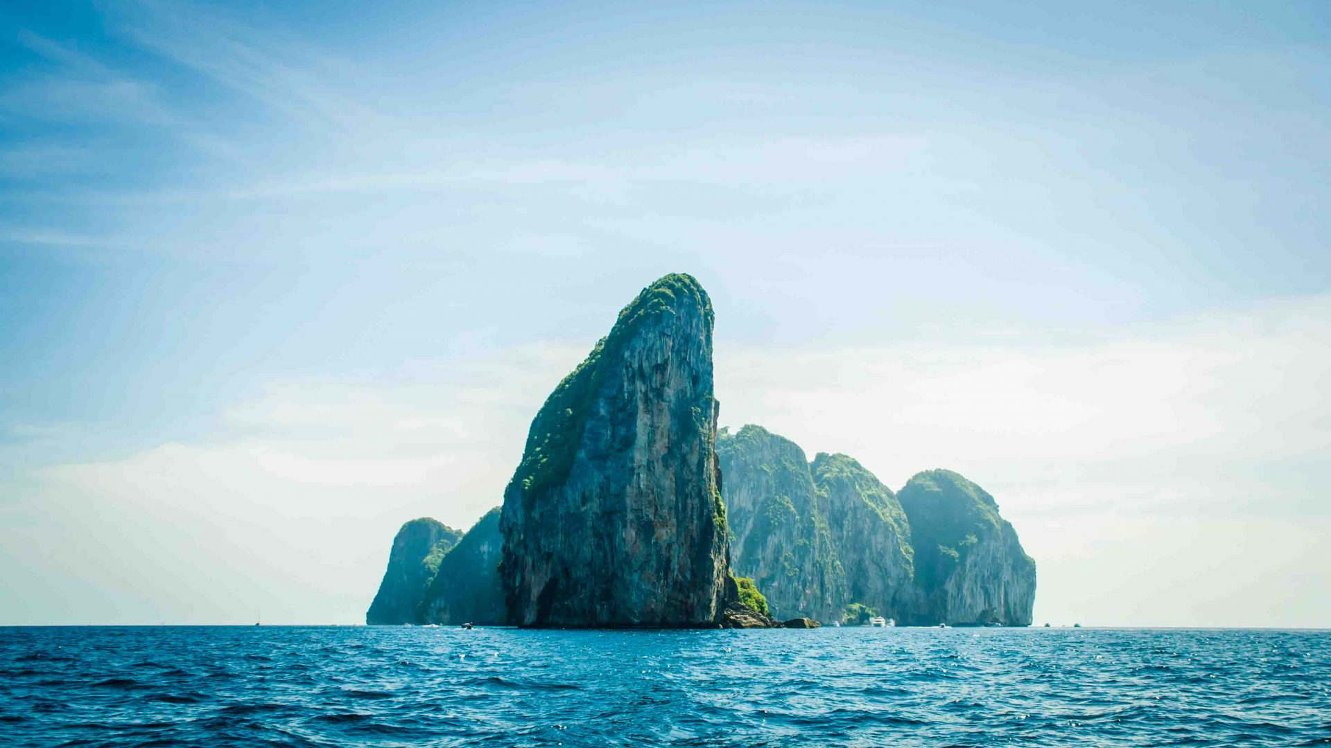 The cliffs of Koh Phang Nga in Thailand jut out of the seas.
