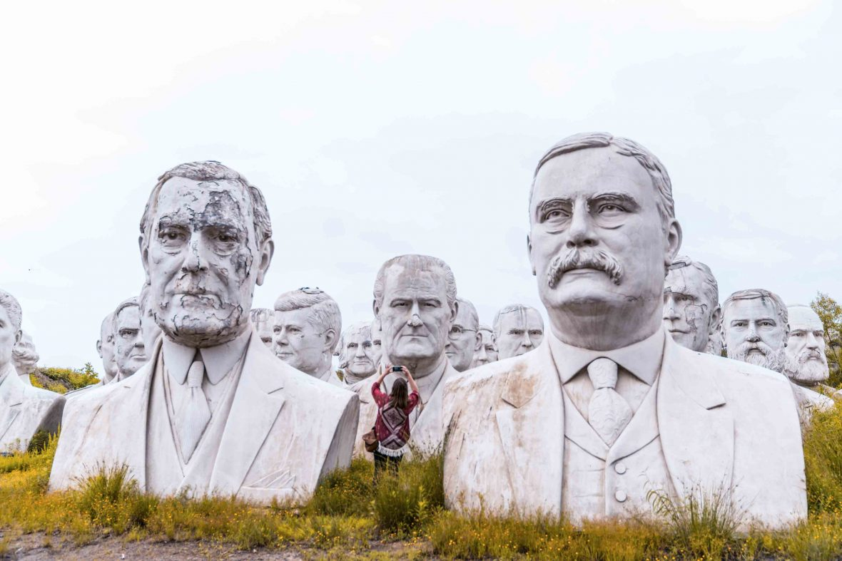 A woman can be seen taking photos of the busts or former US presidents which occupy the land of Croaker farmer Howard Hankins in rural Virginia.
