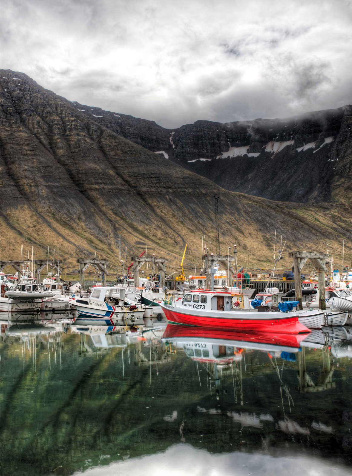 The fishing boats look picturesque against the mountains in the village of Ísafjörður