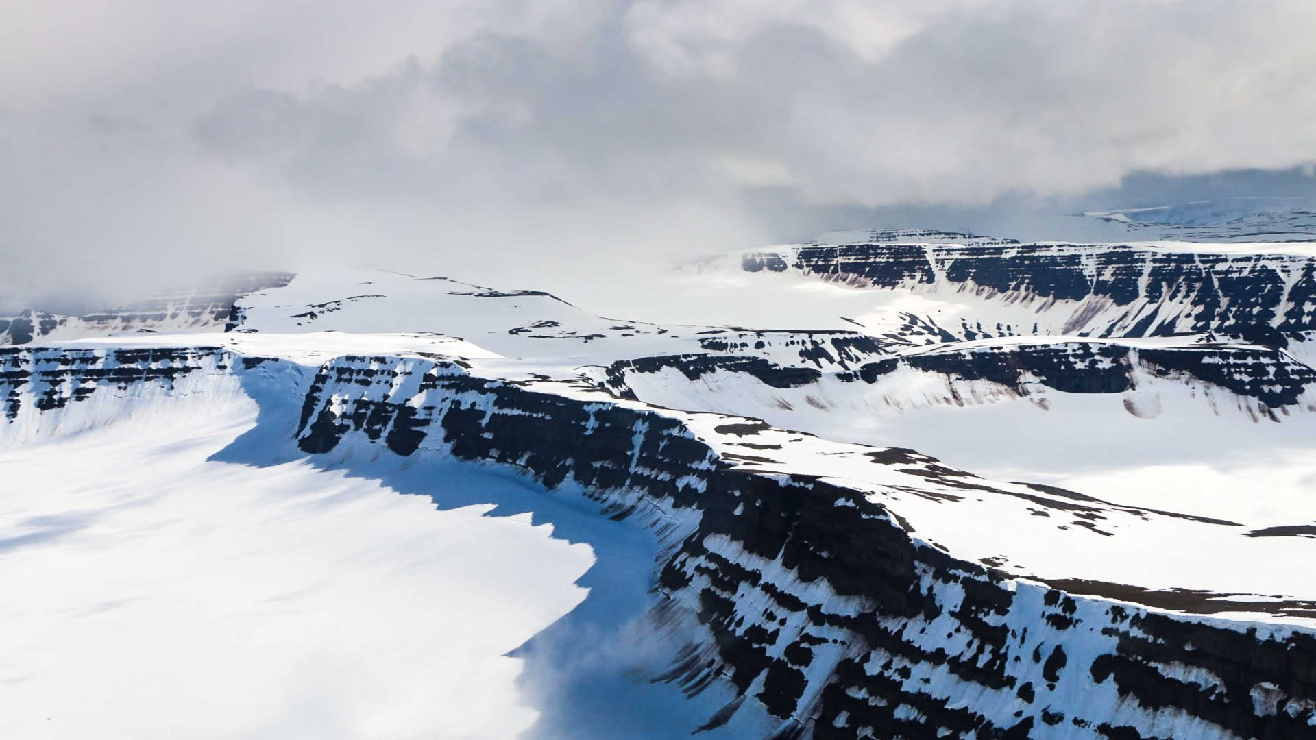 Snow covers mountains, glaciers and volcanoes in Iceland.