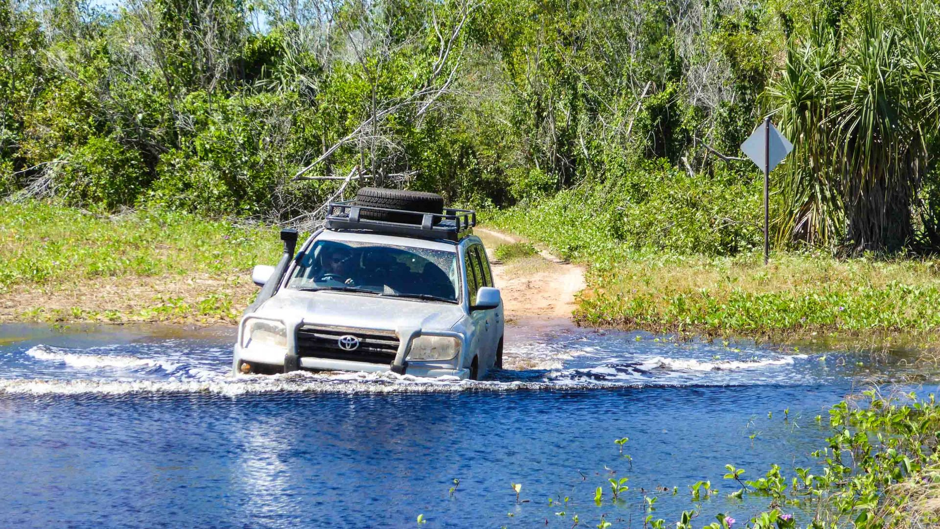 Driving the 4x4wd through the river in the Cobourg Peninsula, Australia.