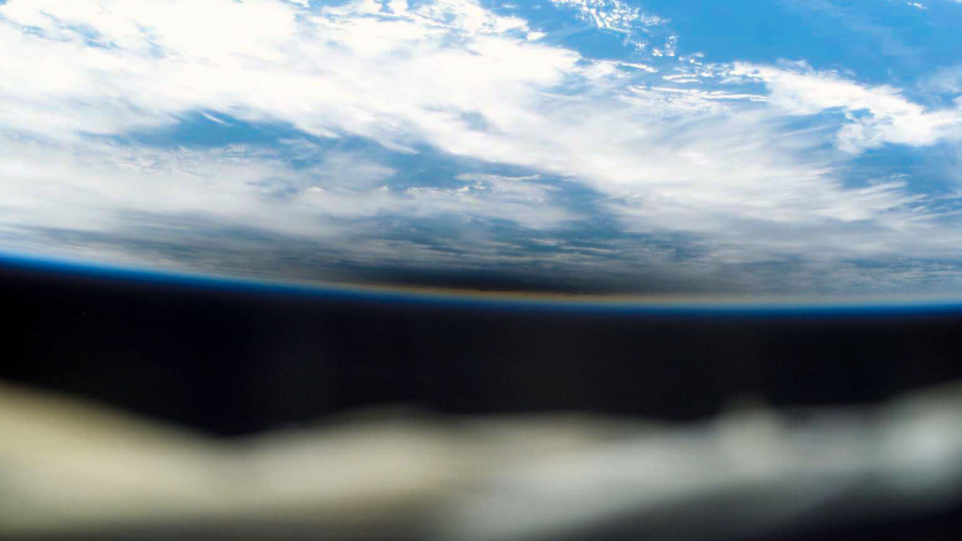 International Space Station crew capture the shadow (the dark area) cast by the moon during a total solar eclipse.